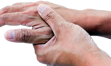 Arthritis sufferer rubbing hands